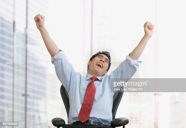 Korean businessman celebrating in office