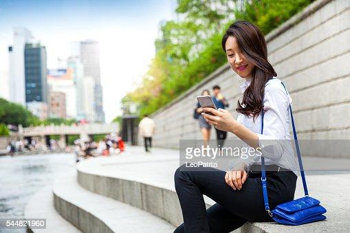 Korean Businesswoman in Seoul downtown having a break