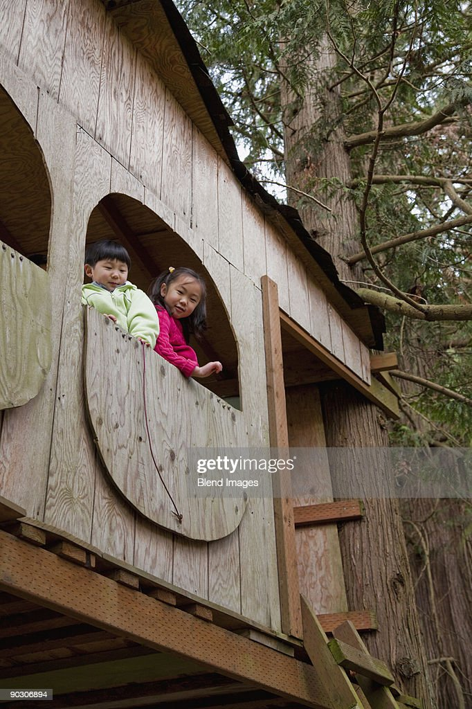 Korean children playing in tree house : Stock Photo