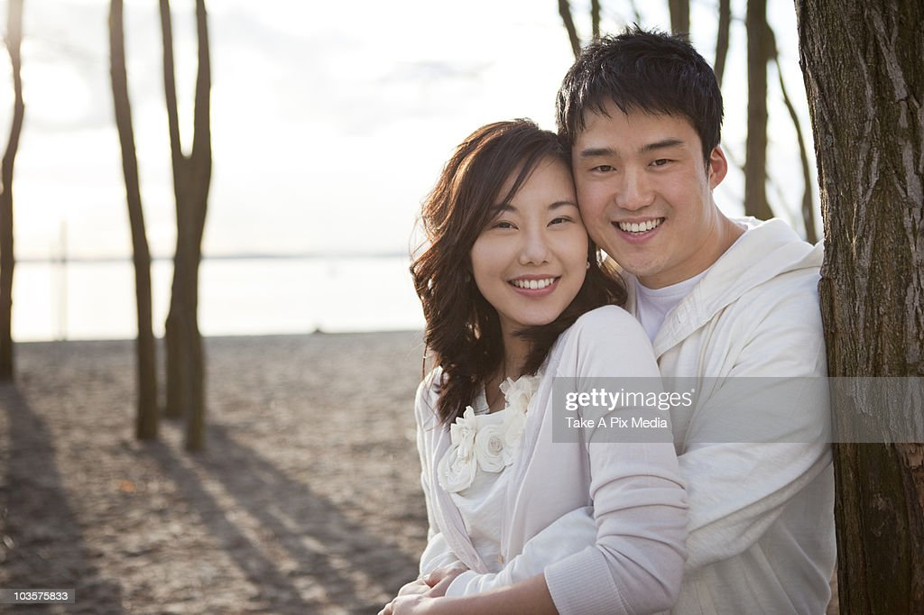 Korean Couple Hugging Outdoors Stock Photo | Getty Images