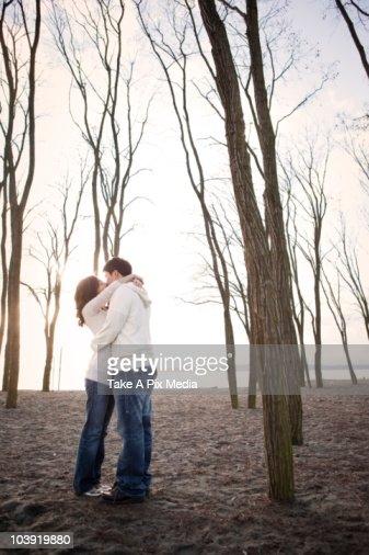 Korean couple kissing on beach : Stock Photo