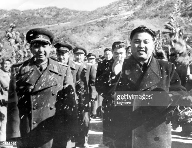 Korean dictator Kim Il Sung begins the evacuation of Chinese troops from North Korea