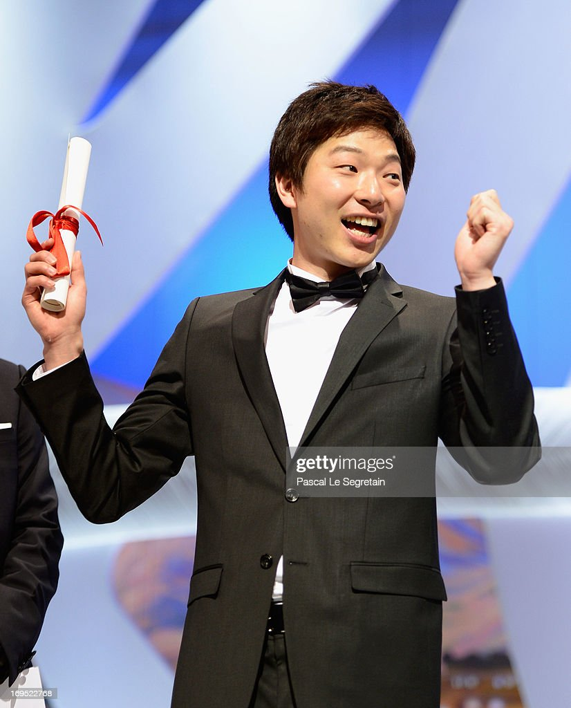 Korean director Moon Byung-gon celebrates on stage after winning the Palme d'Or for Short Film for the film 'Safe' at the Inside Closing Ceremony during the 66th Annual Cannes Film Festival at the Palais des Festivals on May 26, 2013 in Cannes, France.