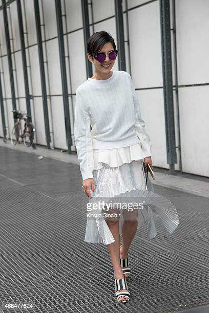 Korean entertainer Nayoung Kim wears a Sacai top and skirt and Chloe shoes on day 7 of Paris Collections Women on March 09 2015 in Paris France