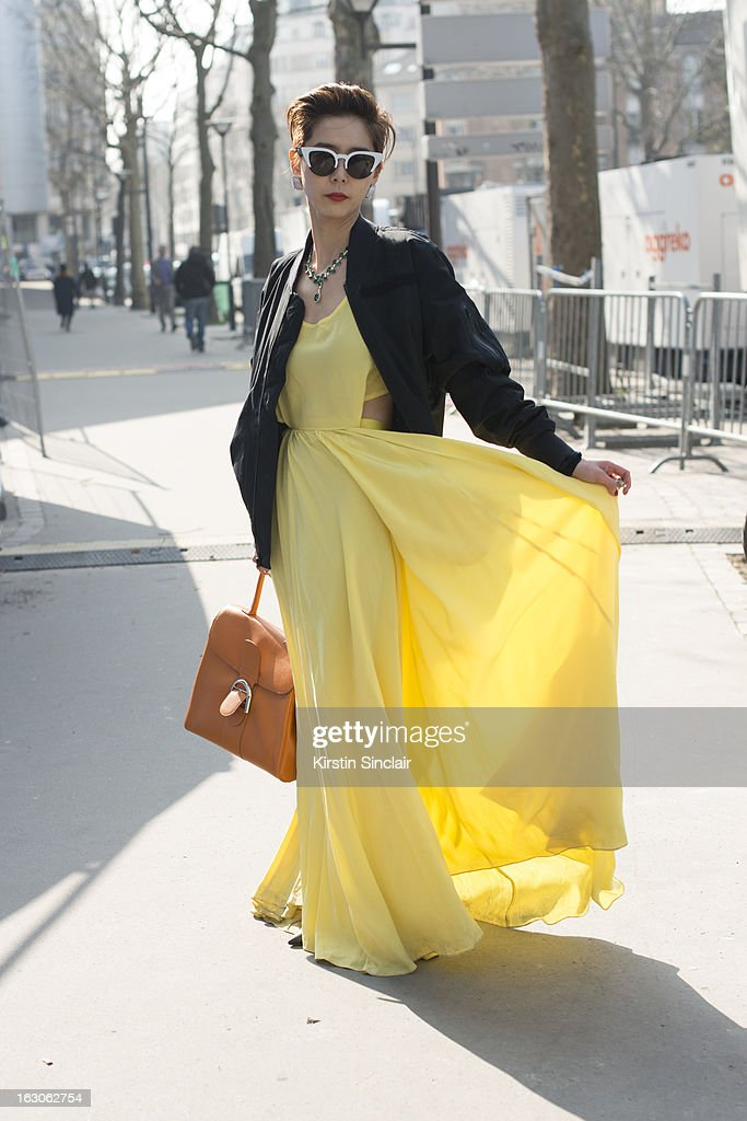 Korean entertainer Nyon Kim wears Push Button dress and glasses, a Nike jacket and a Comme des Garcons bag on day 4 of Paris Womens Fashion Week Autumn/Winter 2013 on March 03, 2013 in Paris, France.