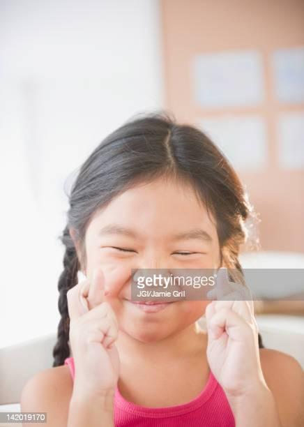 Korean girl crossing fingers