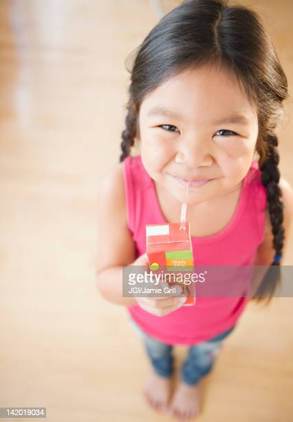 Korean girl drinking juice box