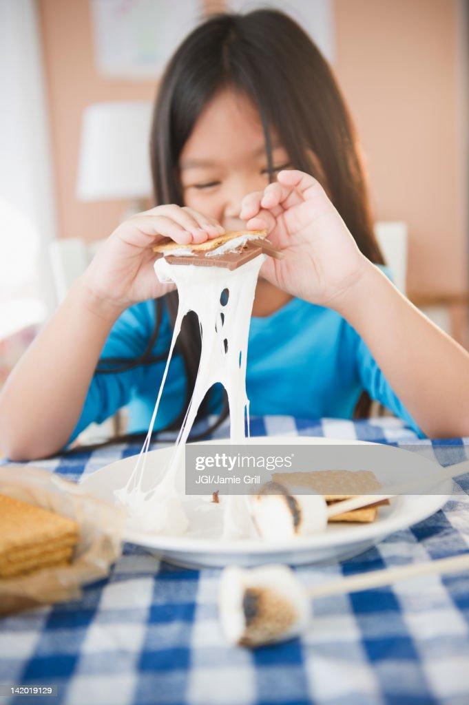 Korean girl eating smores : Stock Photo