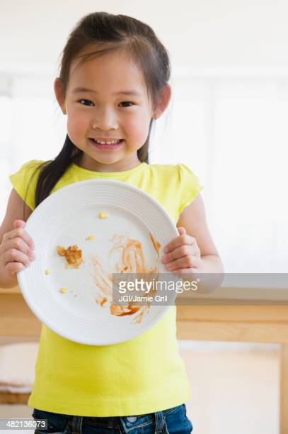 Korean girl showing cleared plate