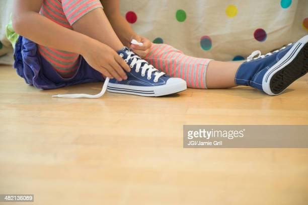 Korean girl tying shoelaces