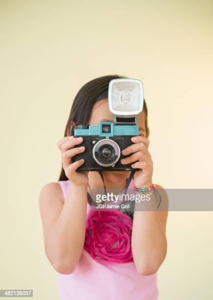 Korean girl using retro camera