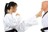 Martial artist executing a front kick.