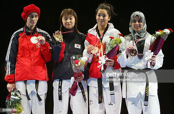 Korean Kim BoHye displays her gold medal flanked by silver medalist Turkish Zeynep Murat and bronze medalists Canadian Orphee Ladouceur and Egyptian...