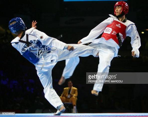 Korean Kim JaeSik fights against Brazilian Marcio Wenceslau during their men's under 62 kg final match at the Taekwondo World Championships in Madrid...