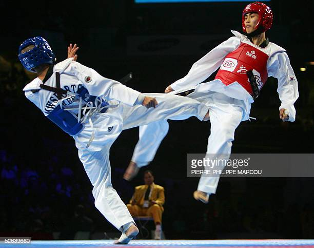 Korean Kim JaeSik fights against Brazilian Marcio Wenceslau during their men's under 62 kg final match at the Taekwondo World Championships in Madrid...