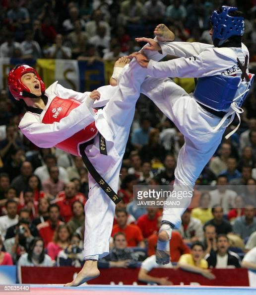 Korean Kim JinHee fights against Iranian Feirollah Nafllah during their men's under 54 kg final match at the Taekwondo World Championships in Madrid...