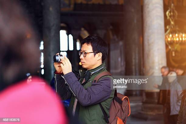 Korean Man taking a photo in Hagia Sophia