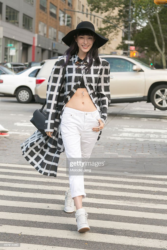 Korean model and Mixop creative director Hyun Jeong Ji wears a blouse by Jardin de Chouette pants by Topshop shoes by Nike and bag by Margiela at...