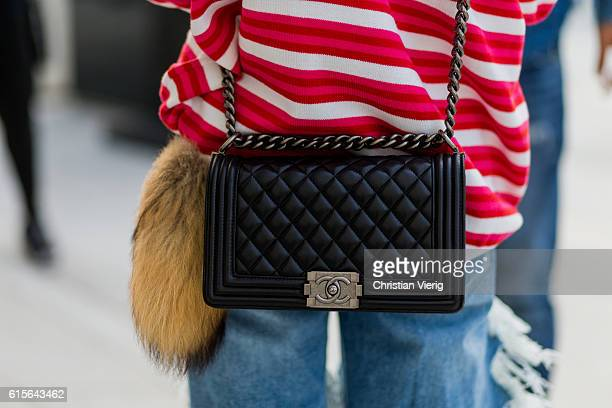 Korean model Kim Myeong Jin wearing a red white striped sweater with the print Economy class and ripped denim jeans and Chanel bag on October 19 2016...