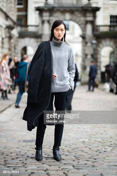 Korean model Pong Lee exits Christopher Raeburn during London Fashion Week Fall/Winter 2015/16 at Somerset House on February 24 2015 in London England