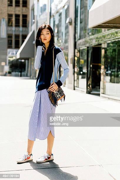 Korean model Sunghee Kim makes a phone call after the Derek Lam show at Skylight Clarkson Sq on September 13 2015 in New York City Sunghee wears a...