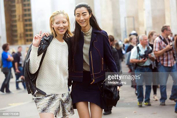 Korean models Soo Joo Park and Jihye Park exit the Leonard Paris show at Palais de Tokyo on Day 7 of Paris Fashion Week Spring/Summer 2015 on...