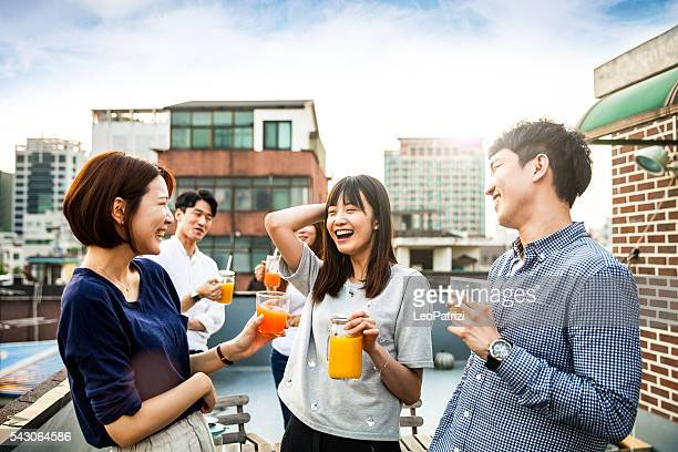 Korean people having rooftop party in Seoul