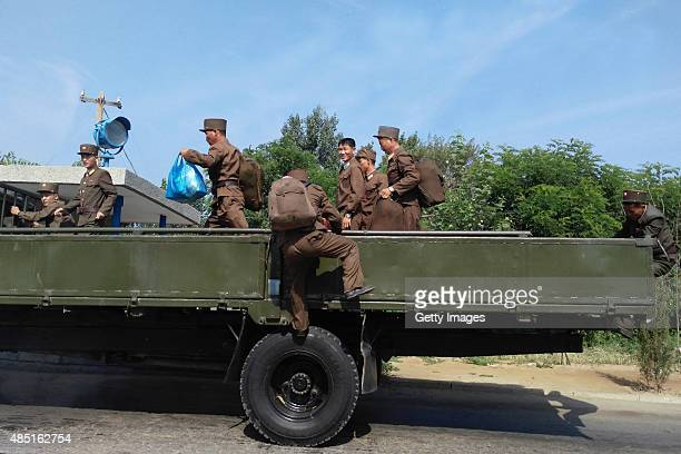 Korean People's Army soldiers climb up a truck on August 23 2015 in Pyongyang North Korea North and South Korea today came to an agreement to ease...