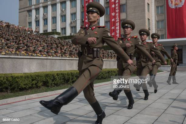 Korean People's Army soldiers march to their positions prior to a military parade marking the 105th anniversary of the birth of late North Korean...