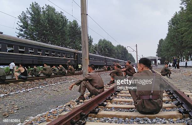 Korean People's Army soldiers take a rest during a train journey amidst tension between North Korea and South Korea on August 21 North Korea North...