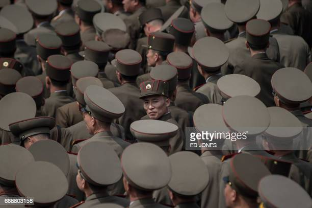 TOPSHOT Korean People's Army soldiers watch a military parade marking the 105th anniversary of the birth of late North Korean leader Kim IlSung in...