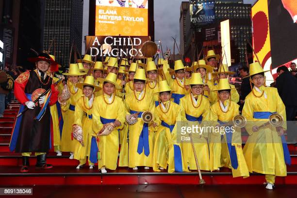 Korean performers pose on the steps during the 100 Days Out 2018 PyeongChang Winter Olympics Celebration Team USA in Times Square on November 1 2017...