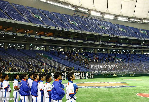 Korean players line up for the national anthem before a friendly match between South Korea and Saitama Seibu Lions at Tokyo Dome on March 2 2009 in...