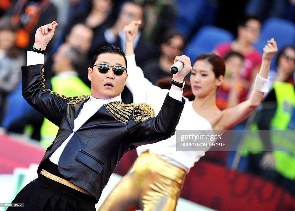 Korean pop artist Park Jae Sang, popularly known as 'Psy', sings as he performs his 'Gangnam Style' song prior to the Italian Cup football final between AS Roma and Lazio at the Rome's Olympic stadium on May 26, 2013.