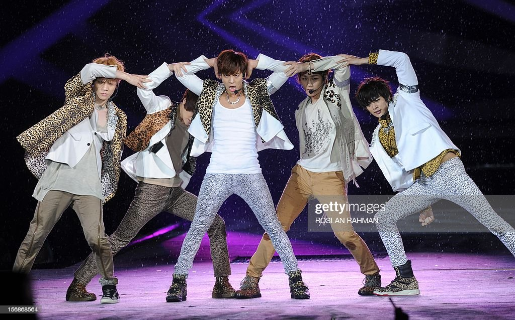 Korean pop group SHINee perform at The Float at Marina Bay in Singapore on November 23, 2012, as part of the SMTOWN Live World Tour III concert gathering the 8 most popular K-pop groups.