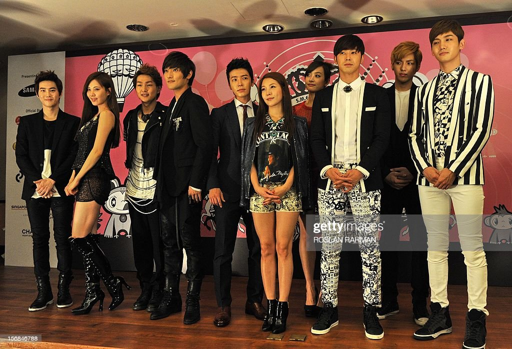 Korean pop groups Kangta, BoA, Yoonho and Changmin of TVXQ, Donghae of Junior, Seohyun of Girls' Generation, Onew of SHINee , Victoria of f(x), Suho and Chris of EXO pose for photographers during a press conference in Singapore on November 23, 2012. The 8 mega-popular K-pop group are in Singapore for the SMTOWN Live World Tour III concert on November 23.