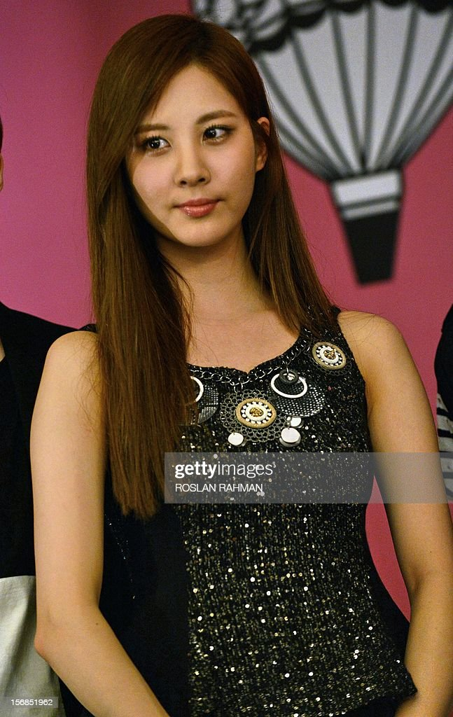 Korean pop Seohyun of Girls' Generation group pose for photographers during a press conference in Singapore on November 23, 2012. The 8 mega-popular K-pop group are in Singapore for the SMTOWN Live World Tour III concert on November 23. s