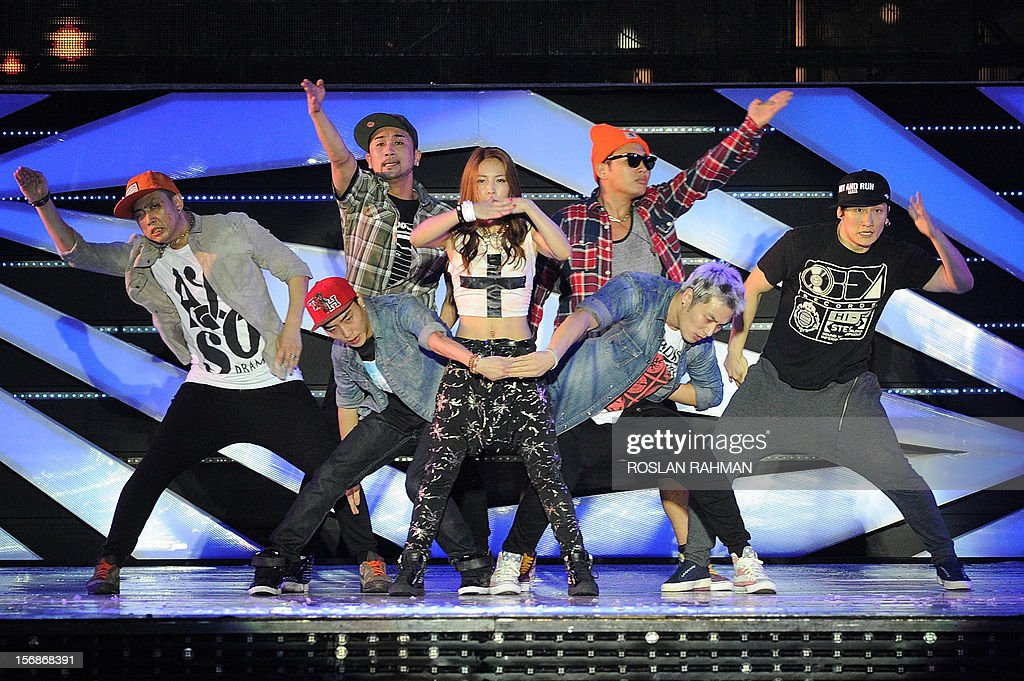Korean pop singer BoA (C) performs at The Float at Marina Bay in Singapore on November 23, 2012, as part of the SMTOWN Live World Tour III concert gathering the 8 most popular K-pop groups.
