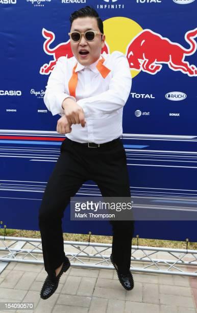 Korean rapper Psy visits the Red Bull Racing garage before the Korean Formula One Grand Prix at the Korea International Circuit on October 14 2012 in...