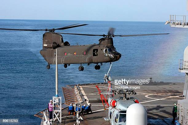 Korean Straits, March 21, 2006 An Army CH-47 Chinook helicopter pulls in for a landing aboard USS Blue Ridge (LCC-19) during a joint Navy-Army training evolution off the coast of Korea.