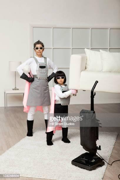 Korean superhero daughter lifting sofa for mother to vacuum underneath