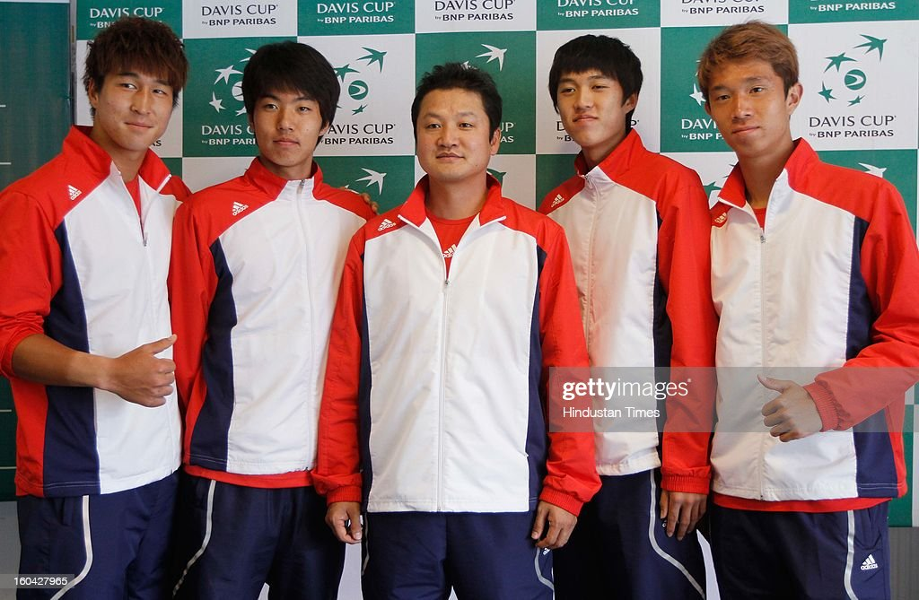 Korean tennis team players Lim Yong-Kyu (L) Nam Ji-Sung (2 L), Cho Min-Hyeok(2 R) and Jeong Suk-Young (R) pose for a photograph after the draw for Davis Cup Asia/Oceania Group I tie against India at Delhi Lawn Tennis Association (DLTA) tennis court on January 31, 2013 in New Delhi, India.