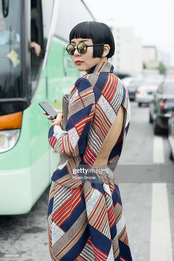 Korean TV personality Ny Kim on day 6 of Paris Fashion Week Spring/Summer 2014, Paris September 29, 2013 in Paris, France.