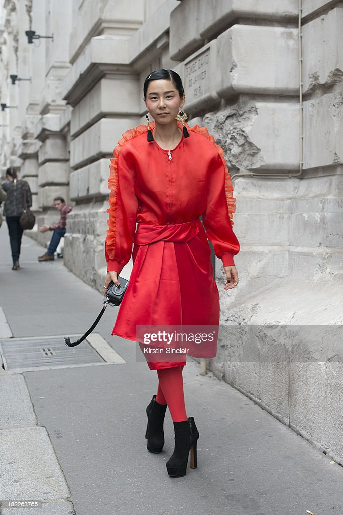 Korean TV personality Ny Kim wears all by Push Button on day 5 of Paris Fashion Week Spring/Summer 2014, Paris September 28, 2013 in Paris, France.