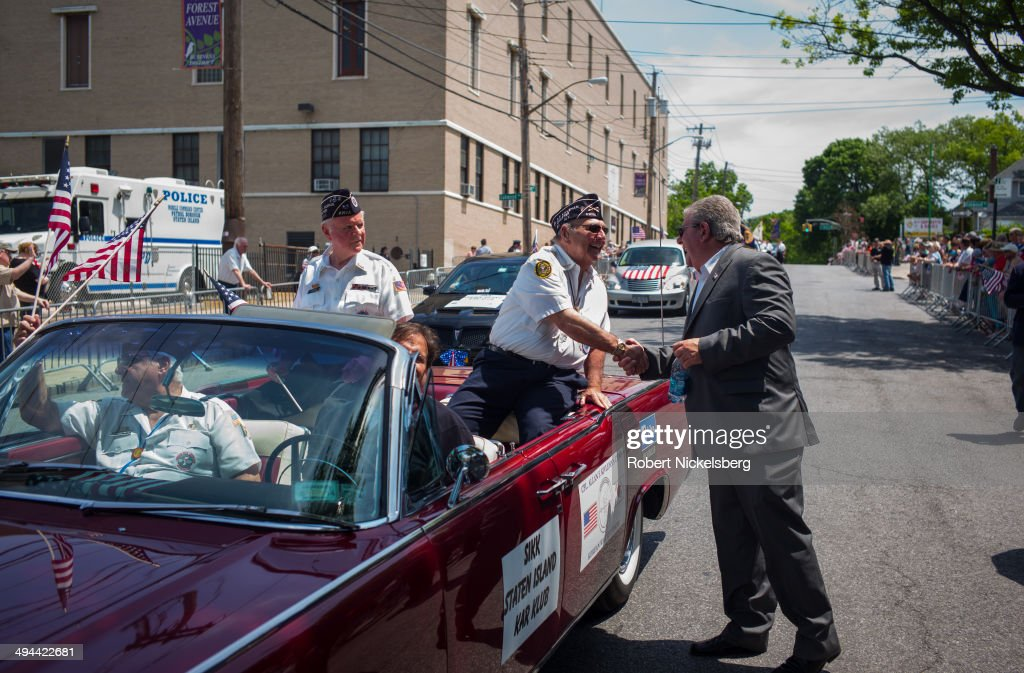 Korean War veterans ride in a convertible car May 26, 2014 during the 96th Staten Island Memorial Day parade in Staten Island, New York. Memorial Day was originally celebrated as Decoration Day after the Civil War in 1868. It became a federal holiday in 1971 and commemorates all those who have died fighting for the U.S. in wars.