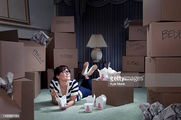 Korean woman eating take-out in new home