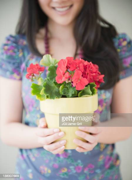 Korean woman holding potted plant