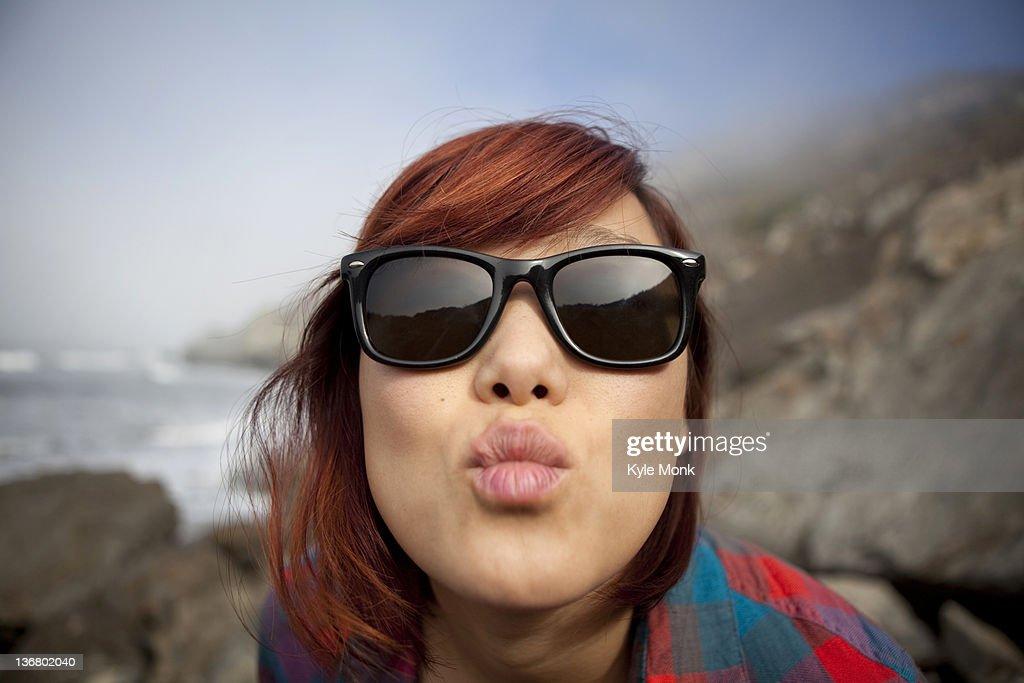 Korean woman puckering her lips