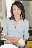 Korean woman washing dishes