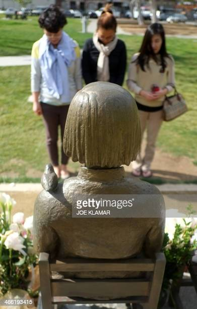 Korean women of Los Angeles observe a minute of silence in the front of the Korean Women Memorial in Glendale California on January 31 2014 Glendale...